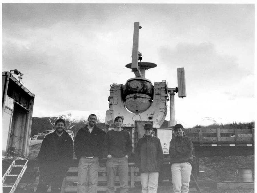 Our crew posing in front of the LIDAR research project that was at the base of the Cog Railway. Testing cloud heights with laser.