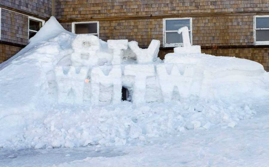 The WMTW Engineers needed to get into the Yankee building to work on equipment and the door was often blocked by snow drifts. May as well show some Channel 8 pride on top of the tunnel!