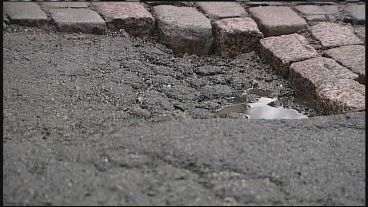 Warmer weather is revealing potholes across Maine as snow melts and pavement buckles.
