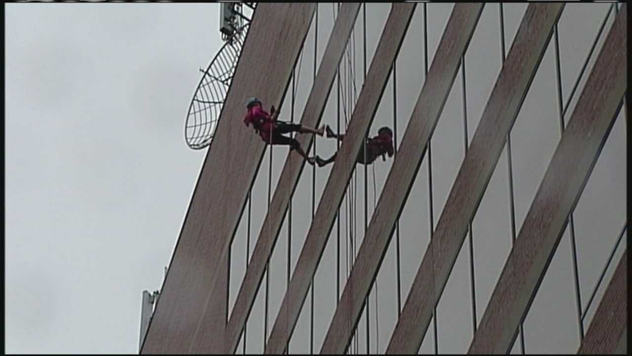 About 100 people took to the edge of One City Center to rappel for Rippleffect.