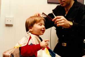 David has always obsessed over his hair. Here he is at his first professional haircut, obviously giving directions.