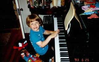 David has always been musical. Here he is playing the piano, but he did not take professional lessons until high school. He was his piano teacher's oldest student.