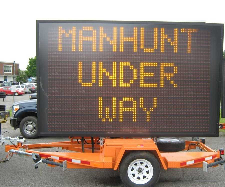 Police have placed these signs warning vacationers about the manhunt and to call 911 if they spot Burton.