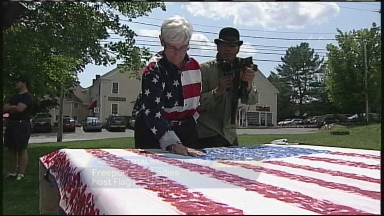 The Freeport Flag Ladies welcomed an artist to Maine on Sunday who is making an American flag out of hand prints.
