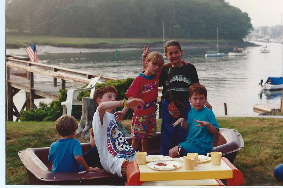 Katie and her big group of cousins grew up spending summers together in Kennebunkport. Here she is with some of them sporting a seriously stylin' outfit circa early 1990s.
