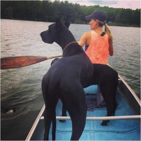 In 1965, Katie's grandfather Julian Thompson built the family a small camp on a lake in Norway. To this day, Katie and her family enjoy going upta' camp with her two Great Danes Lucy and Tony.