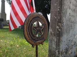 A medallion saying the man fought for the Confederacy remained at the grave.