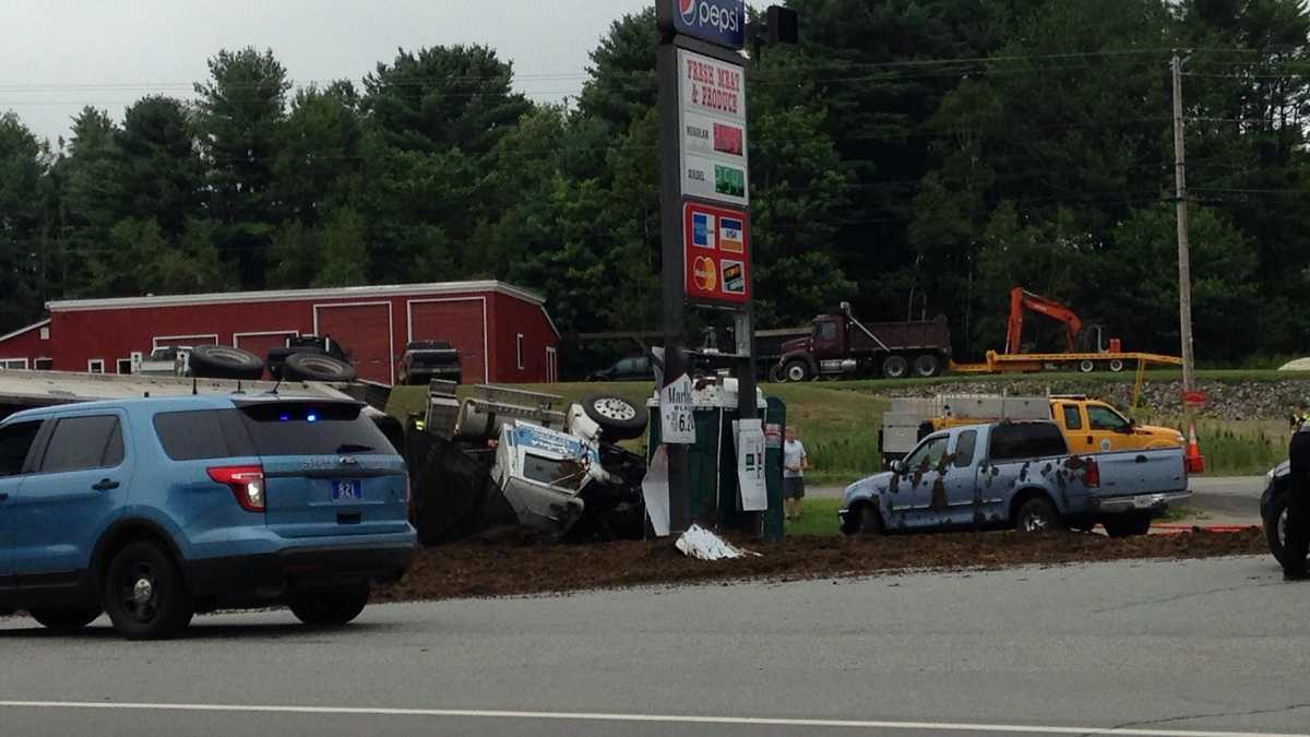 Manure Truck Rolled : Tractor trailer filled with manure rolls over into grocery