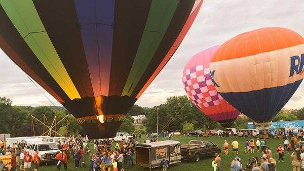 Hot air balloons prepare to take off from Simard-Payne park in Lewiston Saturday morning.