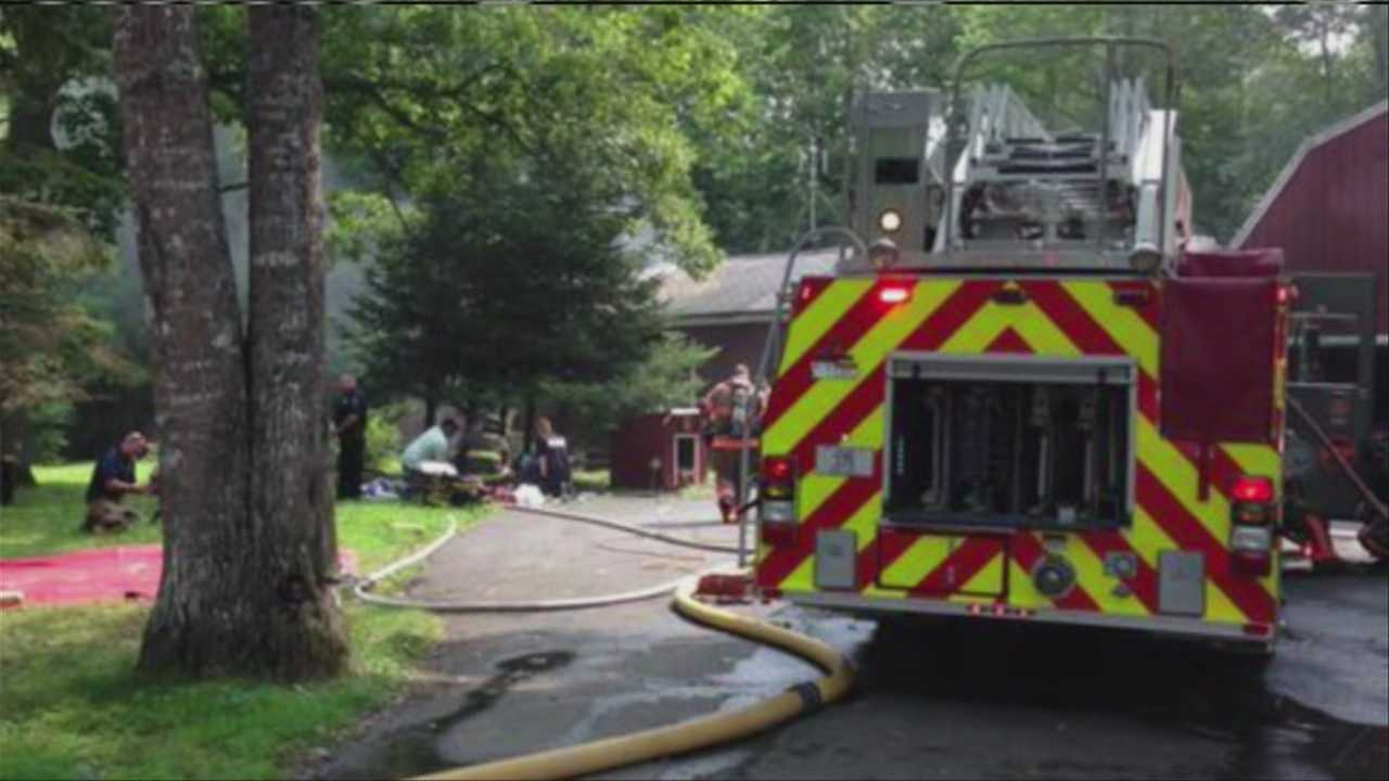 A fire that killed a couple in an Old Town home began when a woman was smoking while on oxygen, officials with the state fire marshal's office said.