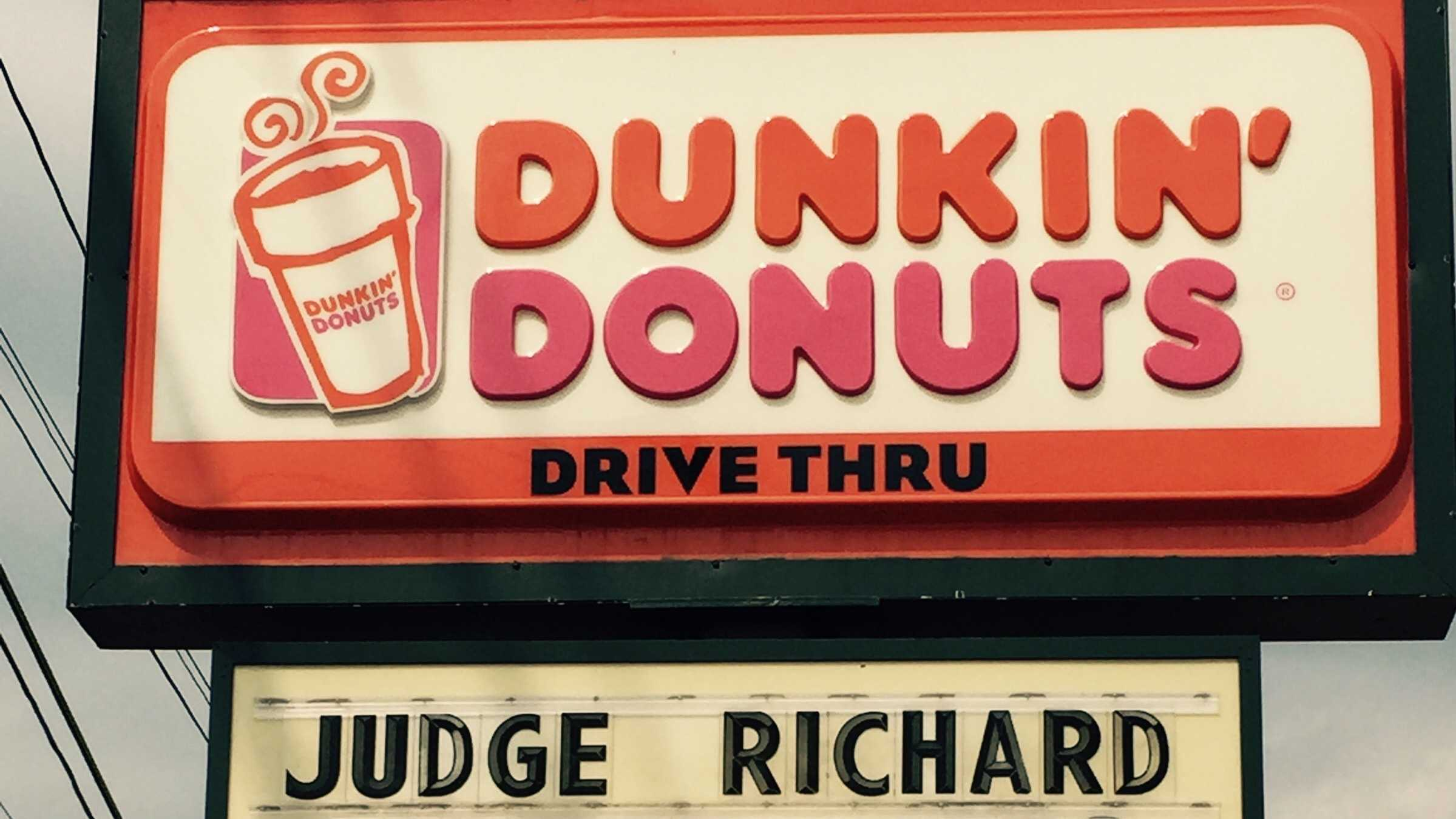 "Mike Conner, the general manager of a Dunkin Donuts in Lewiston, showed his excitement for Brady with a sign at his restaurant reading, ""Judge Richard Berman gets free coffee for life."""