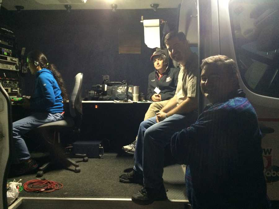 The scene inside the WMTW News 8 satellite truck: director Sarah Quaintance, satellite truck operator Keith Kettelhut, Assistant Chief Engineer Dale Haskell and Operations Manager John Gregory.