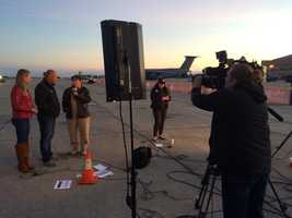 WMTW News 8 This Morning anchors Katie Thompson and Norm Karkos interview a live guest Saturday from the Great State of Maine Air Show at Brunswick Landing while meteorologist Sarah Long prepares for her next weather segment.  Suz Laidman gets the shot.