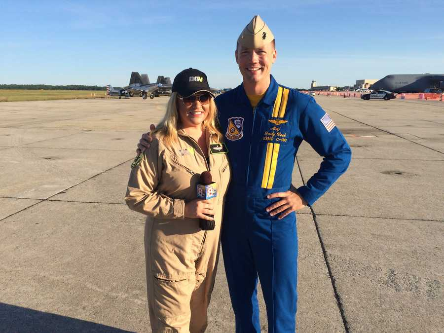 WMTW News 8 This Morning reporter Morgan Sturdivant poses with Major Dusty Cook of the U.S. Navy's Blue Angels, the feature act at the Great State of Maine Air Show at Brunswick Landing.