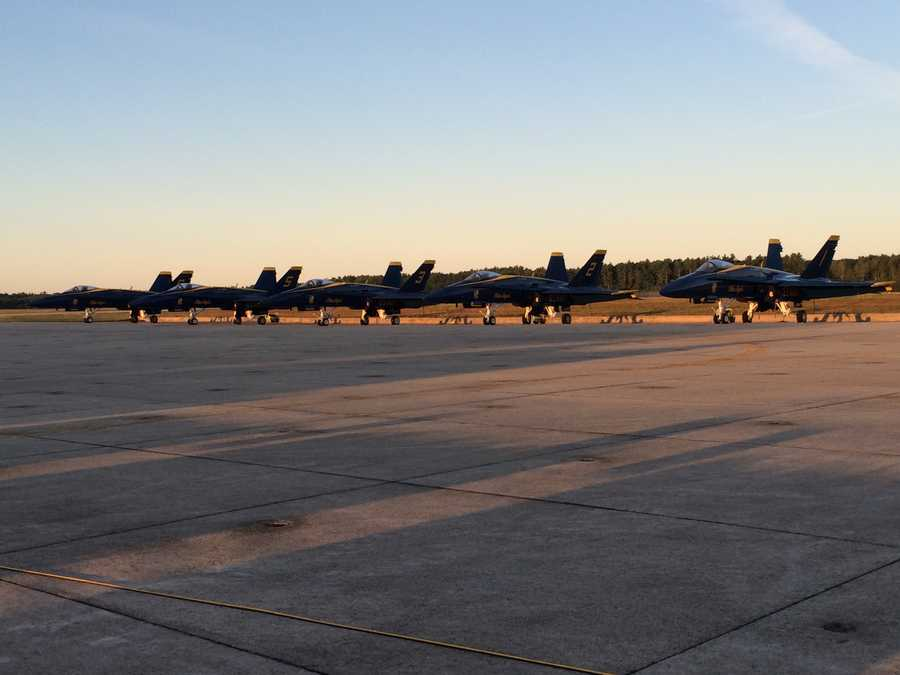 Jets line up across the tarmac as the sun rises Saturday at Brunswick Landing before the Great State of Maine Air Show.