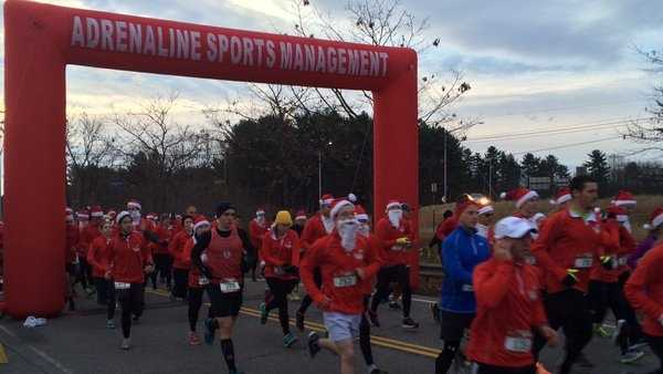 Sea of Santas hustle for Easter Seals Sunday in South Portland