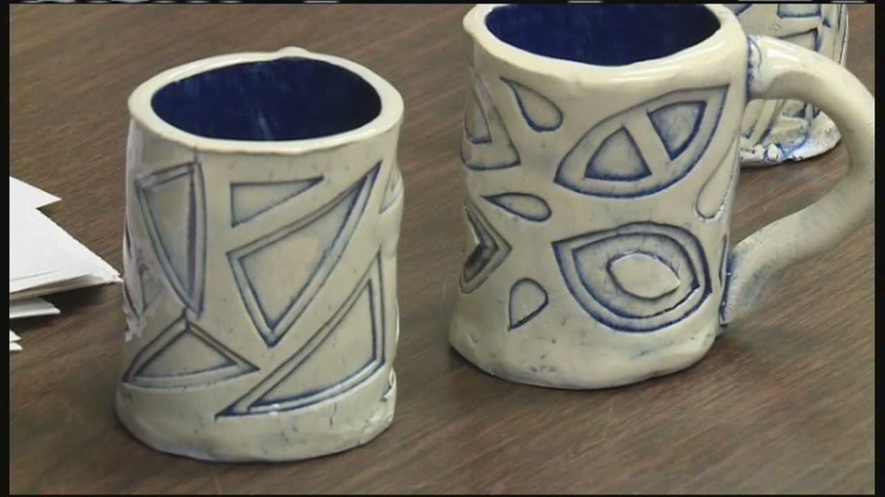 Lewiston High School art students are helping their classmates by selling mugs.