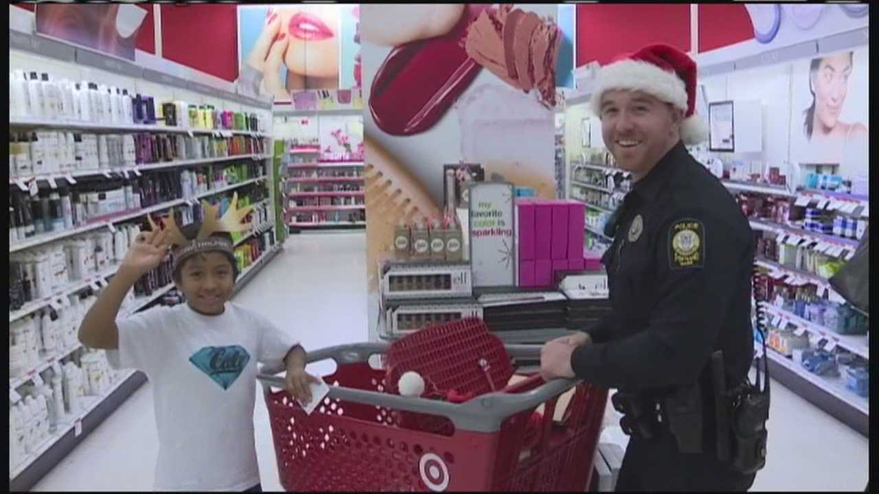 Eight children earned the opportunity to spend the afternoon shopping at Target buying Christmas presents for their families.