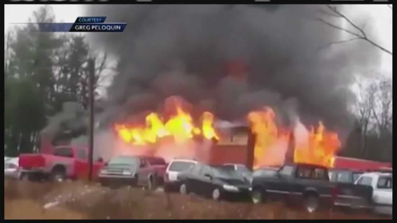 A fire destroys Ovide's Used Cars on Route 302 in Bridgton Thursday.