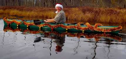 Craig's one man boat parade on Dollof Pond in Conway.