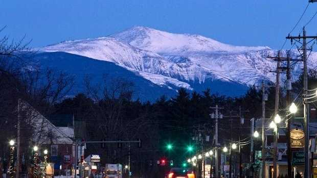 In this Friday, March 13, 2015 photo, Mount Washington is seen at dawn from North Conway, New Hampshire.