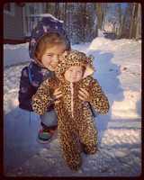 Skye helping Ellie enjoy her first Maine winter