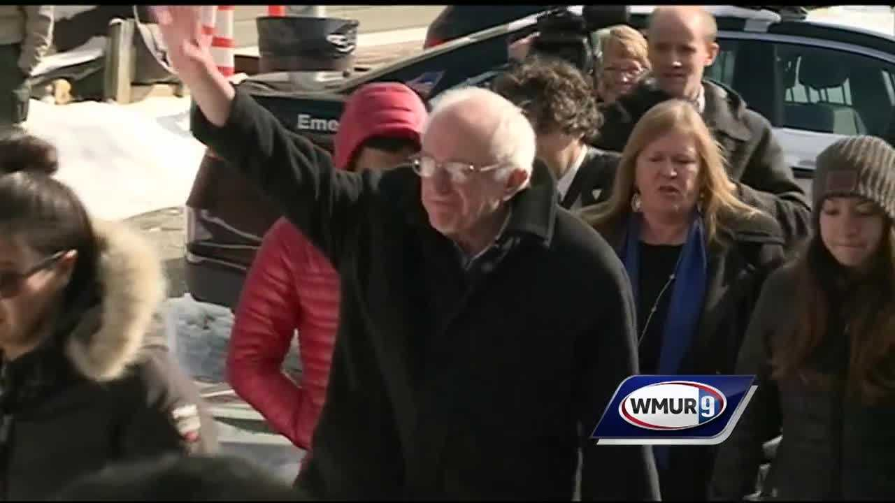 Fans rooted for Democratic presidential hopeful Bernie Sanders as he walked near a polling center in Concord on Tuesday.