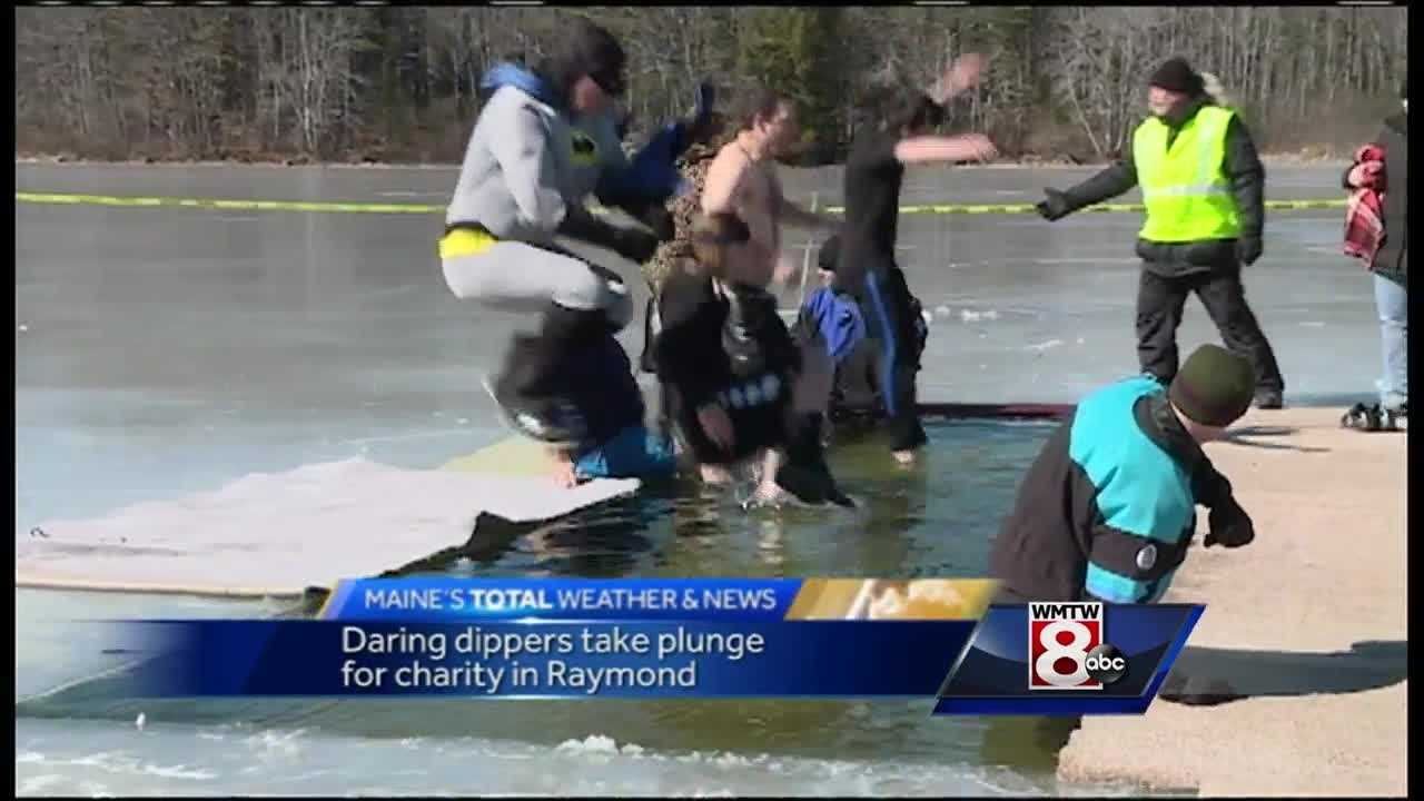 Dozens jumped into Sebago Lake in Raymond Saturday to raise money for the Maine Children's Cancer Program.