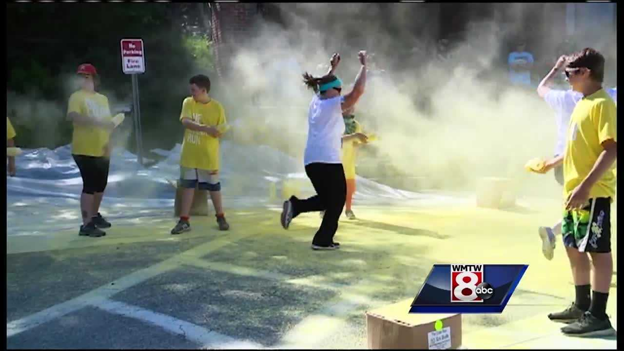 "Runners and colored corn starch combined for what is known as ""the happiest 5K on the planet"" on Sunday."