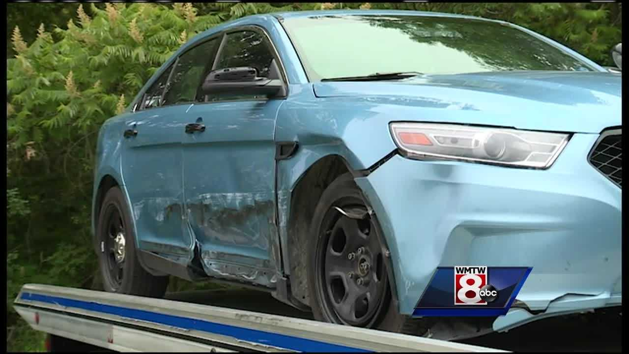 A woman side-swiped a Maine State Police cruiser on the Maine Turnpike, injuring the trooper inside.
