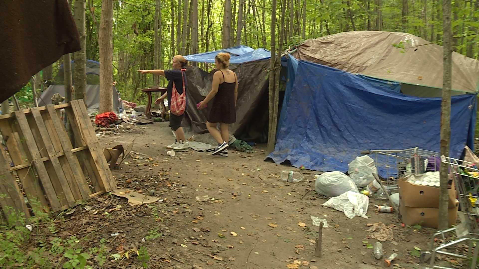 Homeless people living in tents behind a Portland shopping area have been ordered to vacate.