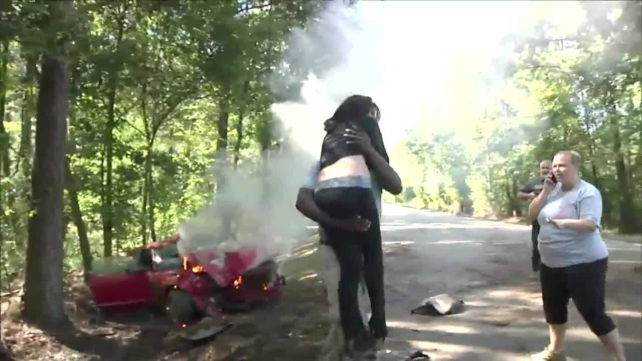 A TV news photographer from Louisiana rescued a woman from her burning vehicle on Tuesday.
