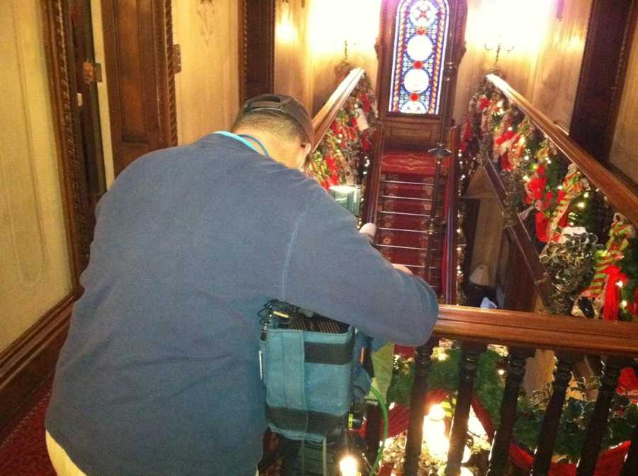 News 8 videographer Jon Cole shooting video of the Victoria Mansion.