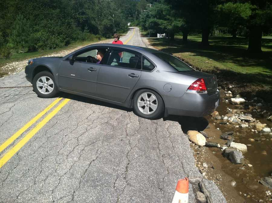 Car stuck in washed out road