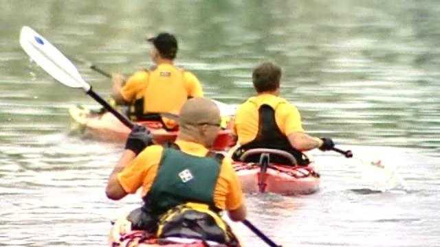 kayakers, kayak (headed to Cooperstown) - 13756723