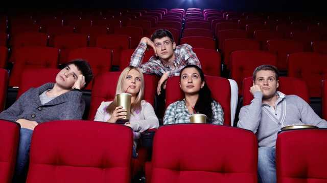 Bored audience in movie theater