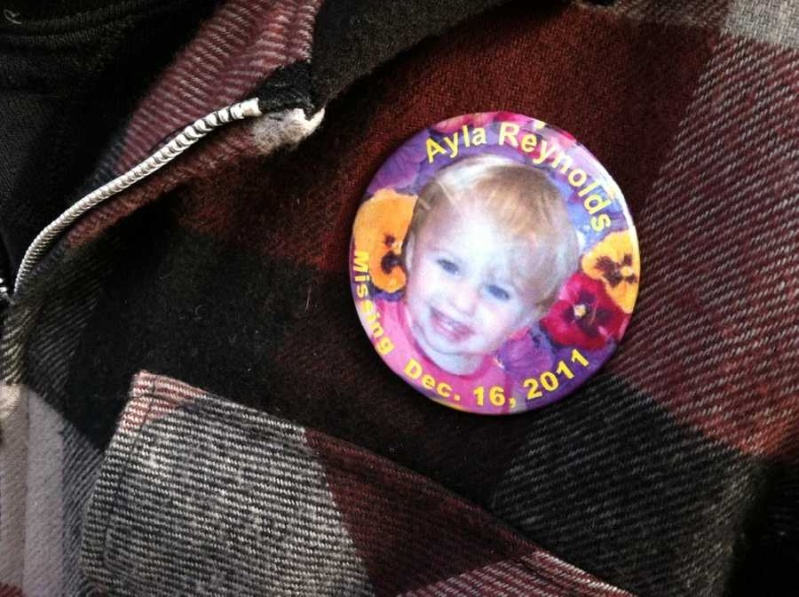 Ayla Reynold's father, Justin DiPietro, had these pins made up with his daughter's face on it.