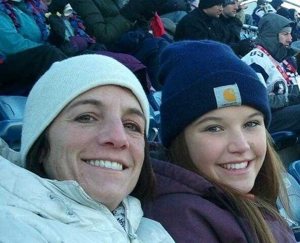 This is a recent photo of Rebecca Mason, 16, with her mom at a New England Patriots game.
