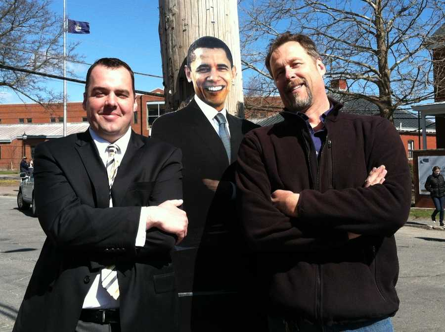 News 8's Paul Merrill and Kevyn Fowler pose with a cutout of President Obama.