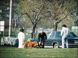 Bulger is seen with his dogs in South Boston before fleeing the area.