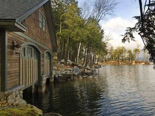 The boathouse has two 30-foot slips, and there are two other docking stations on the property.