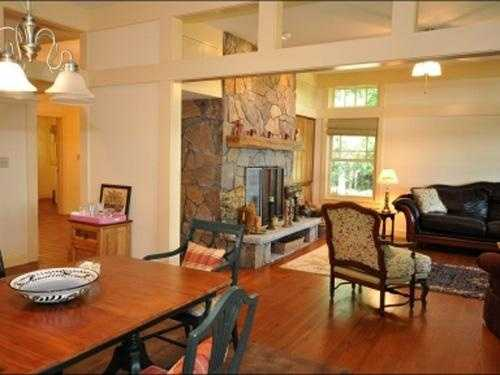The interior features Heart pine floors with a fireplace in the living room.