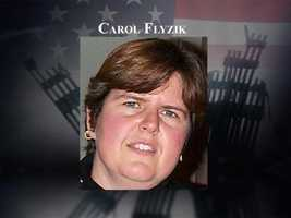 Carol Flyzik, 40, of Plaistow, was flying out for a business trip on Sept. 11, 2001. She loved spending time at her Victorian home with her partner of 12 years.