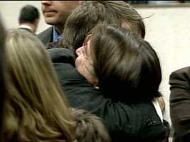 Delker hugs Laura Briggs, the wife of slain officer Michael Briggs, after the trial.