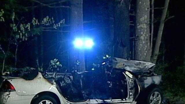 Two people were killed in a fiery crash in Hopkinton early Saturday morning, said police.