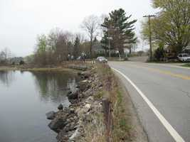 New Castle Route 1B Project: A two-week closure of NH Route 1B in New Castle allows for road and slope improvements between Goat Island and New Castle Island. (picture taken before project started)
