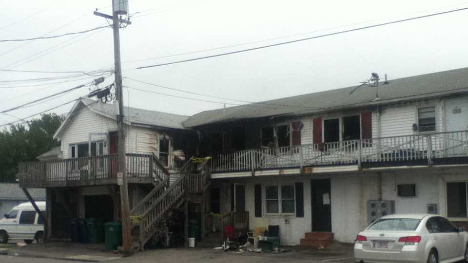 A fire tore through a structure at the corner of Ocean Boulevard and P Street early Saturday morning.