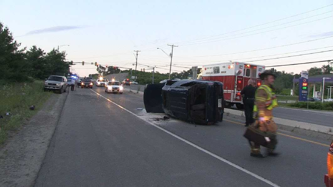 A man was hospitalized after rolling over his SUV in Hudson Saturday night.