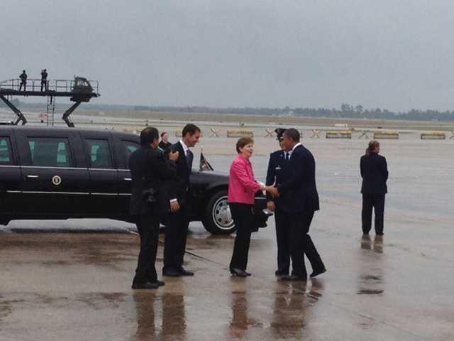 Sen. Jeanne Shaheen greets President Obama.