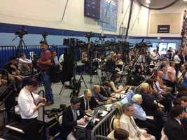 Reporters set up in the gym.